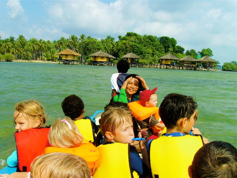 Family-Lina-and-kids-in-safety-boat